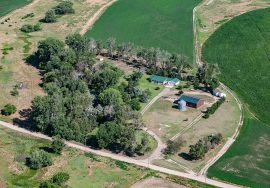 122.92+/- Acres, updated house, art studio, 40′ by 56′ steel building, pond, pasture and dryland crop, Garden County, NE